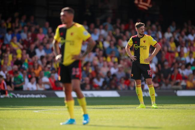 The body language of Jose Holebas and Craig Cathcart speaks volumes. Picture: Action Images
