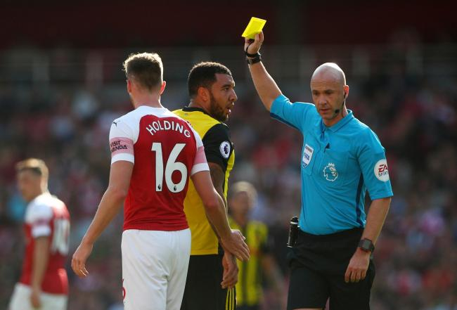 Anthony Taylor books Watford captain Troy Deeney. Picture: Action Images