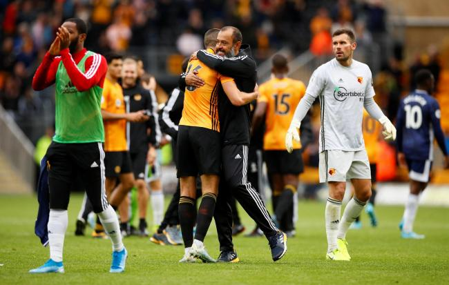 The Wolves boss embraces Conor Coady at full-time. Picture: Action Images