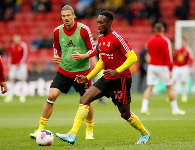 Sebastian Prodl warms up with Danny Welbeck prior to kick-off. Picture: Action Images