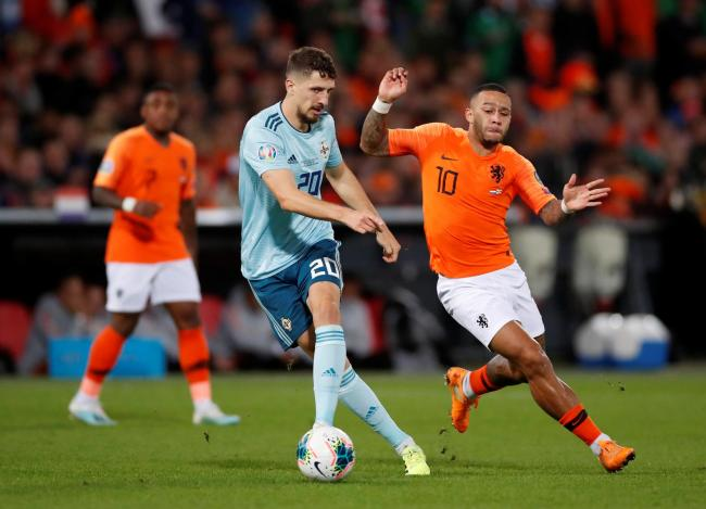Craig Cathcart moves the ball away from Memphis Depay. Picture: Action Images