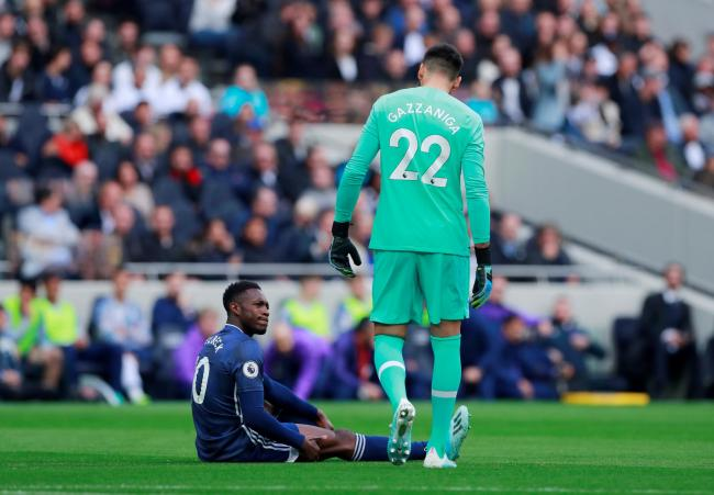 Spurs keeper Paulo Gazzaniga checks on the wellbeing of the Hornets striker after his injury. Picture: Action Images