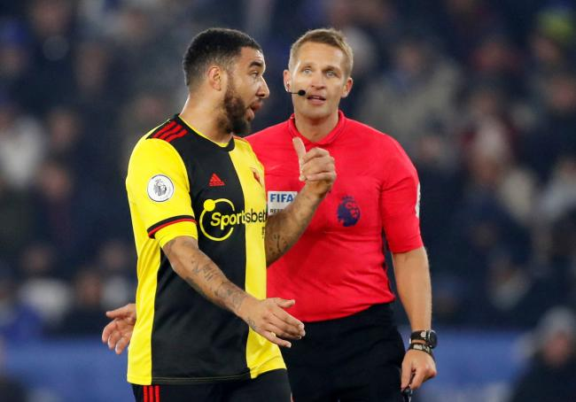 Troy Deeney with Craig Pawson during Watford's defeat away at Leicester. Picture: Action Images