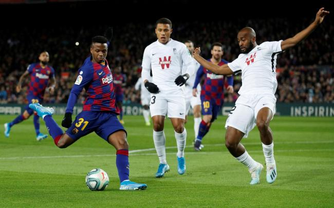 Dimitri Foulquier tackles Barcelona's Ansu Fati. Picture: Action Images