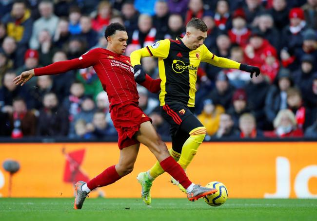 Trent Alexander-Arnold challenges Gerard Deulofeu during Liverpool's victory over the Hornets in December. Picture: Action Images