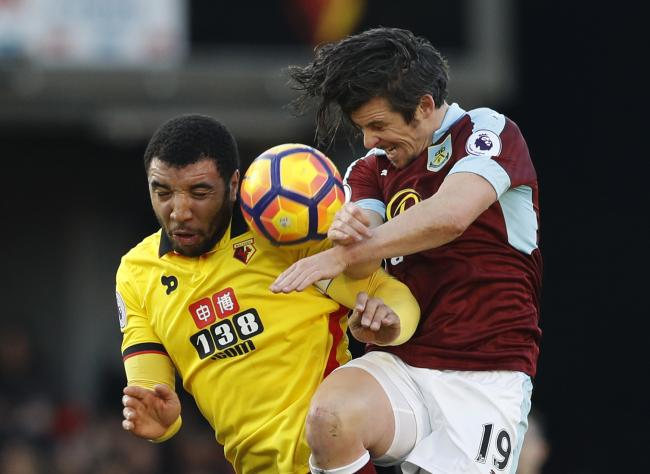 Troy Deeney clashes with Joey Barton on the pitch. Picture: Action Images