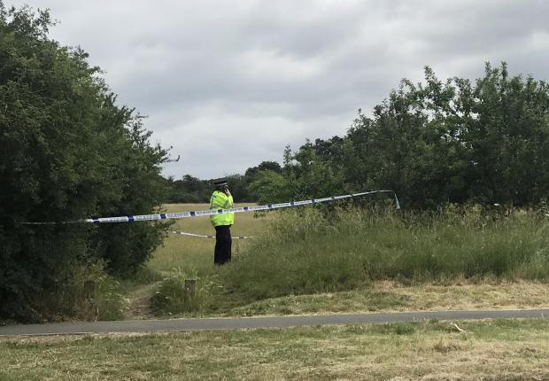 Harrow Times: Police at the crime scene (Photo: SWNS)