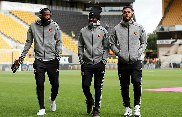 Watford's Domingos Quina, centre, and Andre Gray, right, have apologised. Chalobah, left, was dropped too for come into contact with those who attended gathering.