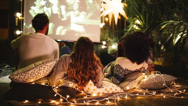 Harrow Times: Sit back and relax with a projector and outdoor screen. Credit: Getty Images / M_A_Y_A