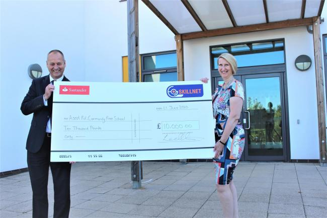 Skillnet managing director Eugene Lowry hands over the donation to Cathy Elsey