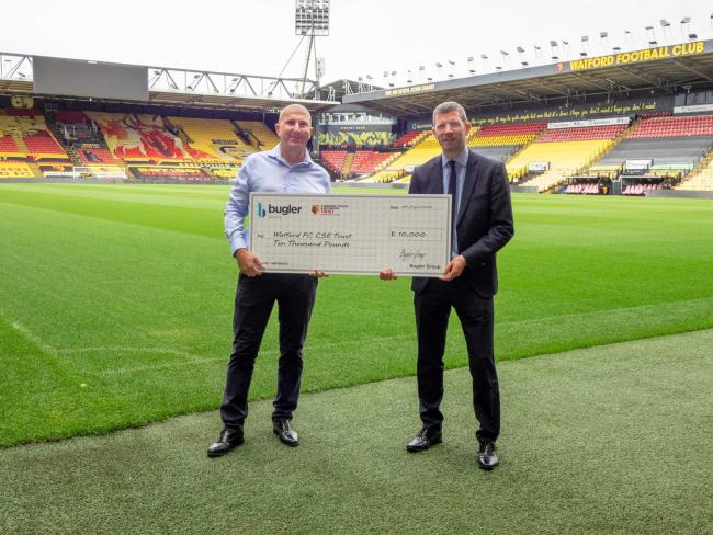 Andy Bugler presents the donation to Rob Smith