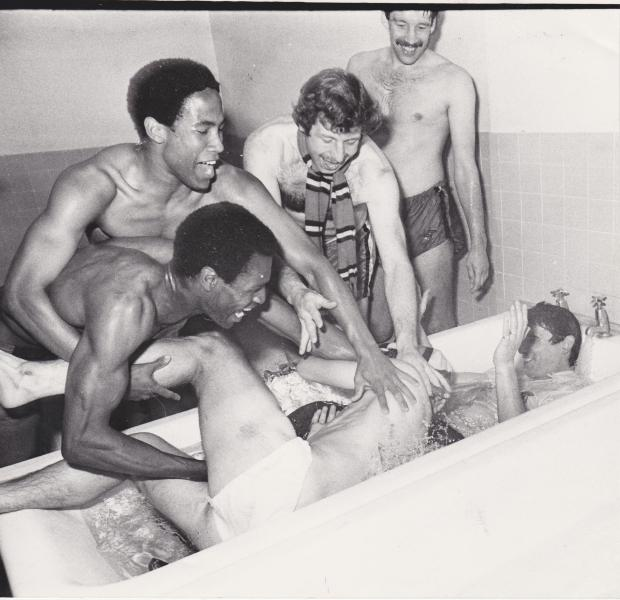 Harrow Times: Joyful scenes as Luther Blissett, John Barnes and Gerry Armstrong are among the players to give their boss a celebratory soaking in the bath