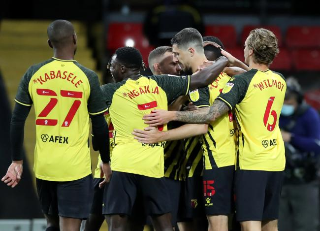 Craig Cathcart is congratulated after scoring what proved to be the winner. Photos: Action Images