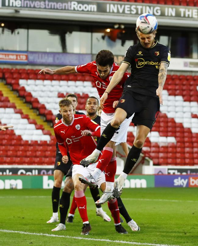 Ben Wilmot climbs above the Barnsley defence to win a header. Photo: Action Images