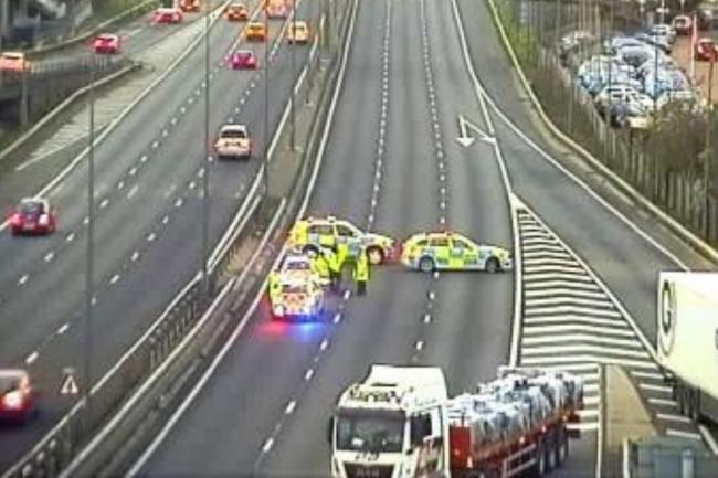 Police cars seen on the M1 southbound after a man fell from a height. Photo: Highways England
