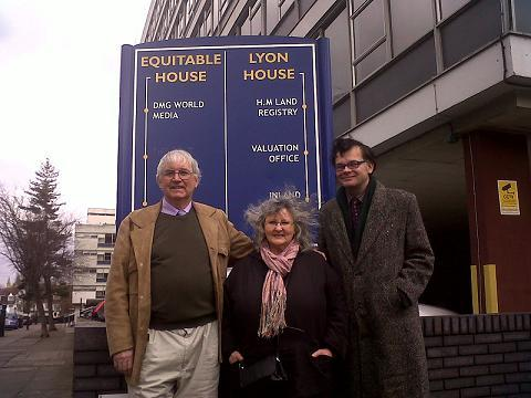 Mr Stoodley, Mr Burch, and his wife Christine, outside the Land Registry office in Harrow.