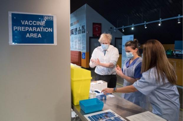 Harrow Times: The Prime Minister at a vaccination centre at The Hive, home of Barnet FC. Credit: PA