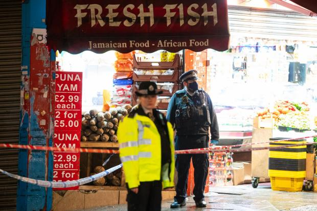Harrow Times: Police attend the scene of a stabbing on London Road, near the junction of Oakfield Road, in Croydon