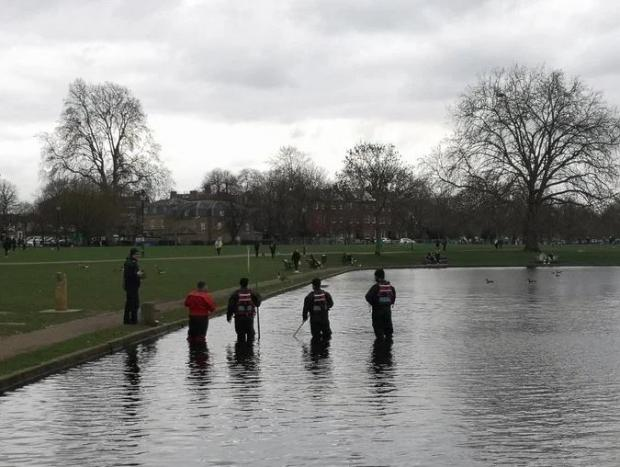 Harrow Times: Police are seen searching Clapham Common ponds todayCredit: Sky News
