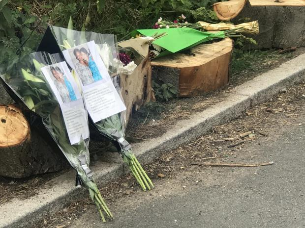 Harrow Times: Flowers placed outside Fryent Park (Photo: SWNS)
