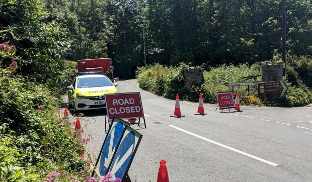 Harrow Times: Police at the scene in Devon (Photo: SWNS)