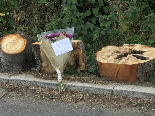 Harrow Times: Flowers left at the scene after the murder (Photo: SWNS)