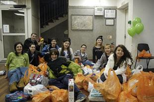 Rabbi Andrew Shaw and Stanmore & Canons Park Synagogue helpers with shopping collected for Watford New Hope Trust for the Homeless
