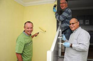 Hendon and Finchley MP Mike Freer with Barnet Councillors Melvin Cohen and Andrew Harper help to paint a hallway and flat at Norwood residential accomodation in Oakfield Road, Finchley Central