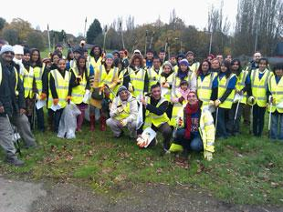Volunteers from Bhaktivedanta Manor gather to pick up litter in Maxwell Hillside Park and Parkfields in Borehamwood