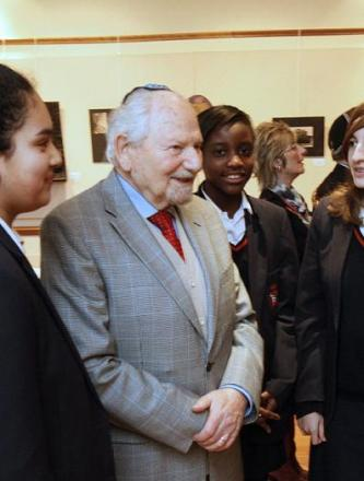 Herman Hirschberger at a Holocaust Memorial Day event with pupils from Bentley Wood High School.