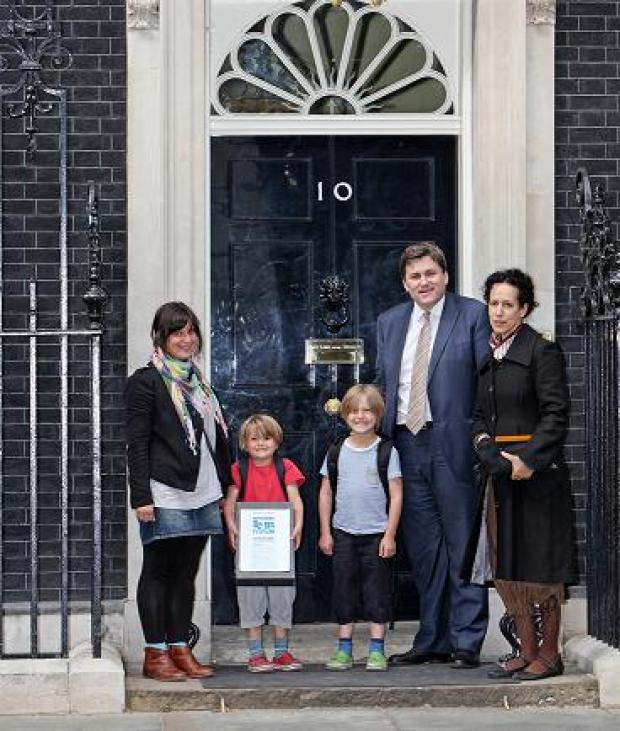 Deputy Mayor for Policing Kit Malthouse hands the petition in at Downing Street with Claire Lambert and her children and Ms Reeves