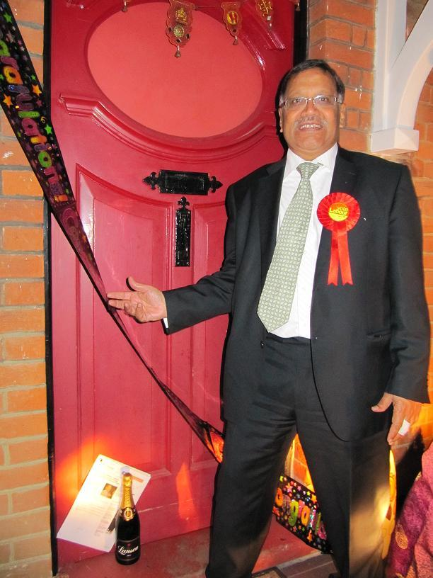 A neighbour left congratulatory banners and a bottle of champagne outside his front door