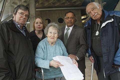 Pamela Gershon (centre), Navin Shah (centre right) and campaigners prepare to hand in the petition last night.