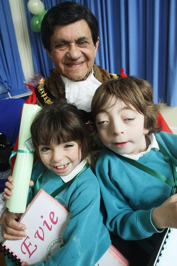 Mayor of Harrow Nizam Ismail with Evie Beety-Jenkins, 6, and Daniel Smith, 7.