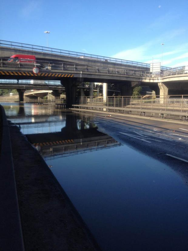 A burst main caused extensive flooding of the North Circular Road under the Brent Cross Flyover
