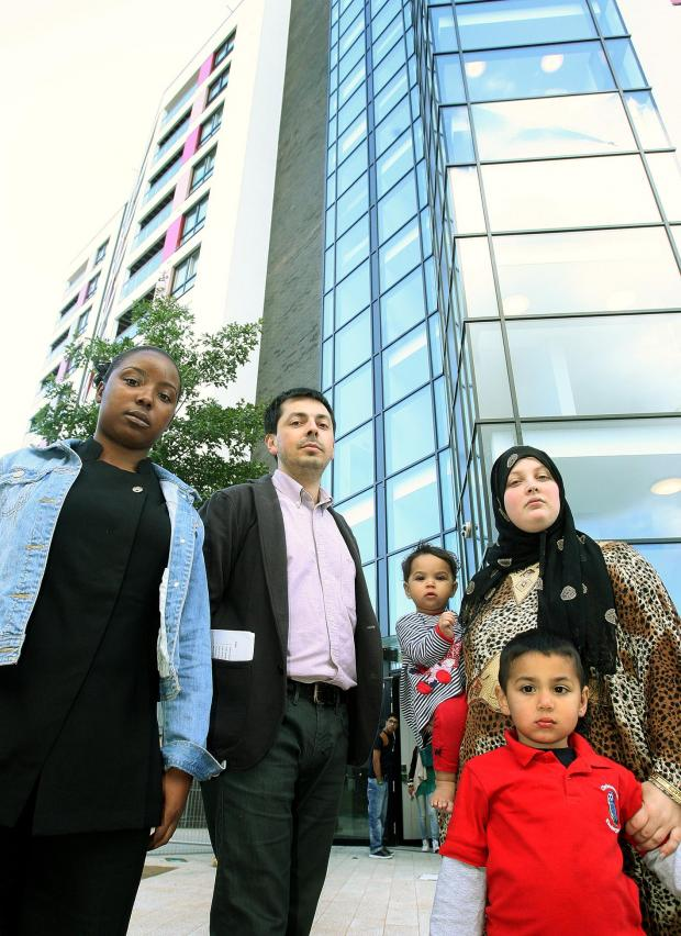 Tenants Gee Joseph, Luis Vargas, Cindel Keogh and two children Hussain and Miraim outside the troubled block.