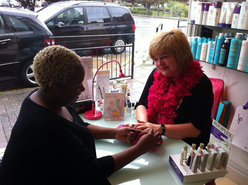 Naomi Miller (left) beautician pictured with client Rosemary McLaughlin