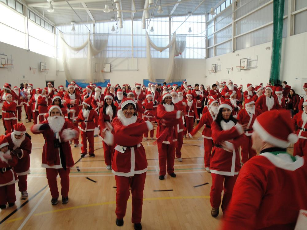 The Santas took part in a group warm up before the Dash