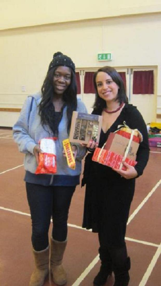 Slimming World member Nashika Davis with Abbie Alter and some of the treats