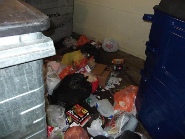 The bins are overflowing because they have not been emptied for so long