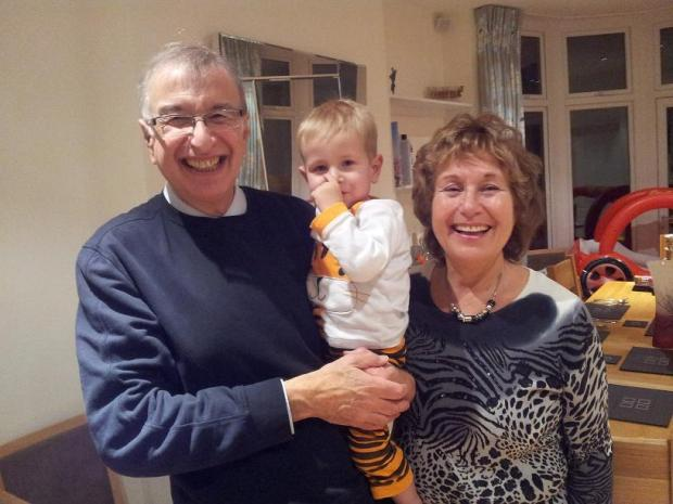 Sharon Berger (right) and her husband with their 20-month-old grandson