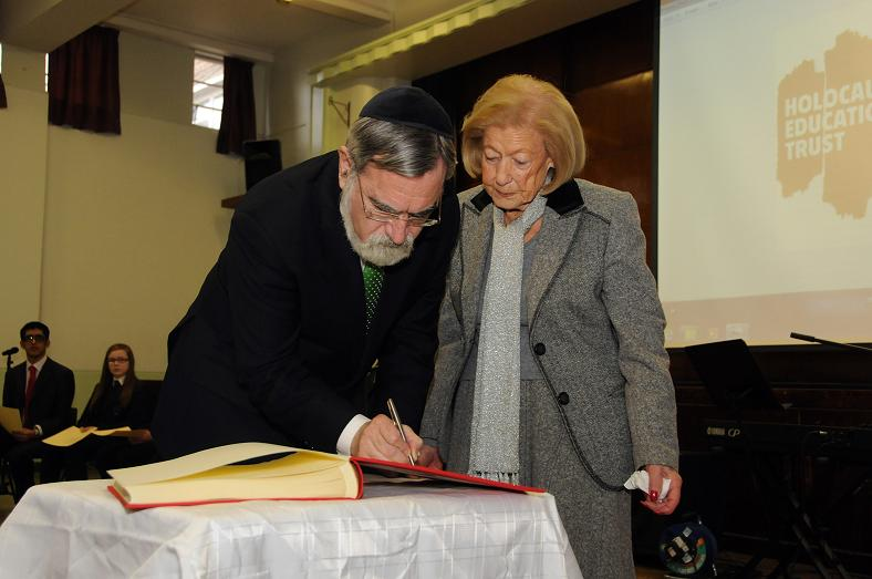 Chief Rabbi, Lord Sacks, and Gena Turgel sign the Holocaust Educational Trust's Book of Commitment
