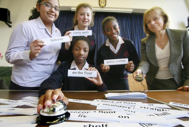 Harrow Times: Shivani, 13, Lauren, 13, Charlotte, 13, and Tiarna, 13, with head of modern foreign languages, Mrs Hutchinson
