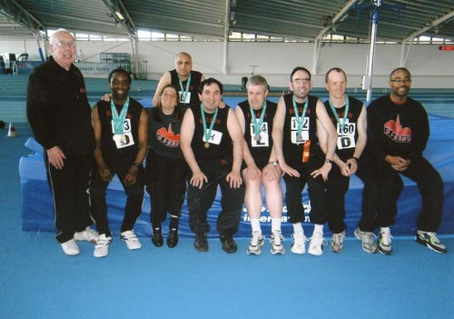 Harrow Gateway director Ken Towns with the Harrow branch of Special Olympics at the Lee Valley Indoor Athletics stadium