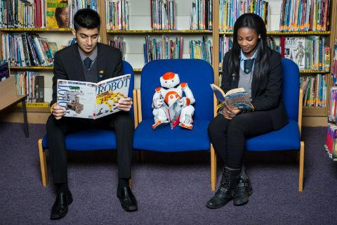 Head Boy Rishi Bhudia and Head Girl Vanessa Magnusen with NAO robot. Photo taken by Steve Foster