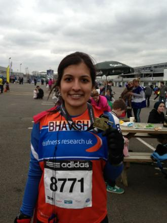 Hearing expert completes half marathon for charity