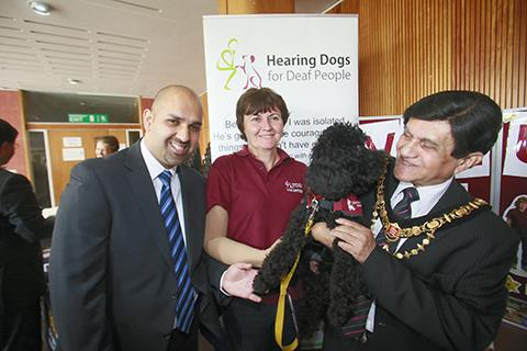 Asif Iqbal MBE and Mayor of Harrow councillor Nizam Ismail at the Hearing Dogs for Deaf People stall