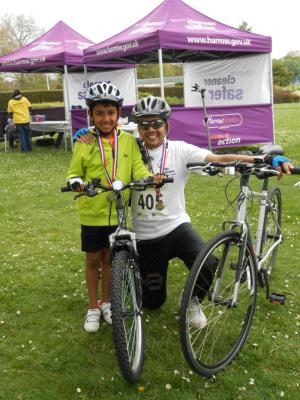 Families were among more than 100 people who took part in a cycle challenge that raised £8,000 for St Luke's Hospice.