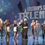 The cast performing Living the Dream at their audition in January