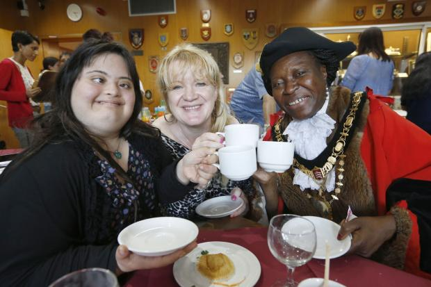 Carers sip tea with mayor